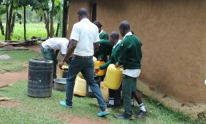 The Water Project:  Students Fetching Water From Home
