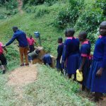 The Water Project: Jinjini Friends Primary School -  Pupils In Line For Water