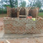 The Water Project: Friends School Mutaho Primary -  Fitting The Latrine Doorframes