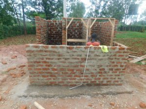 The Water Project:  Fitting The Latrine Doorframes