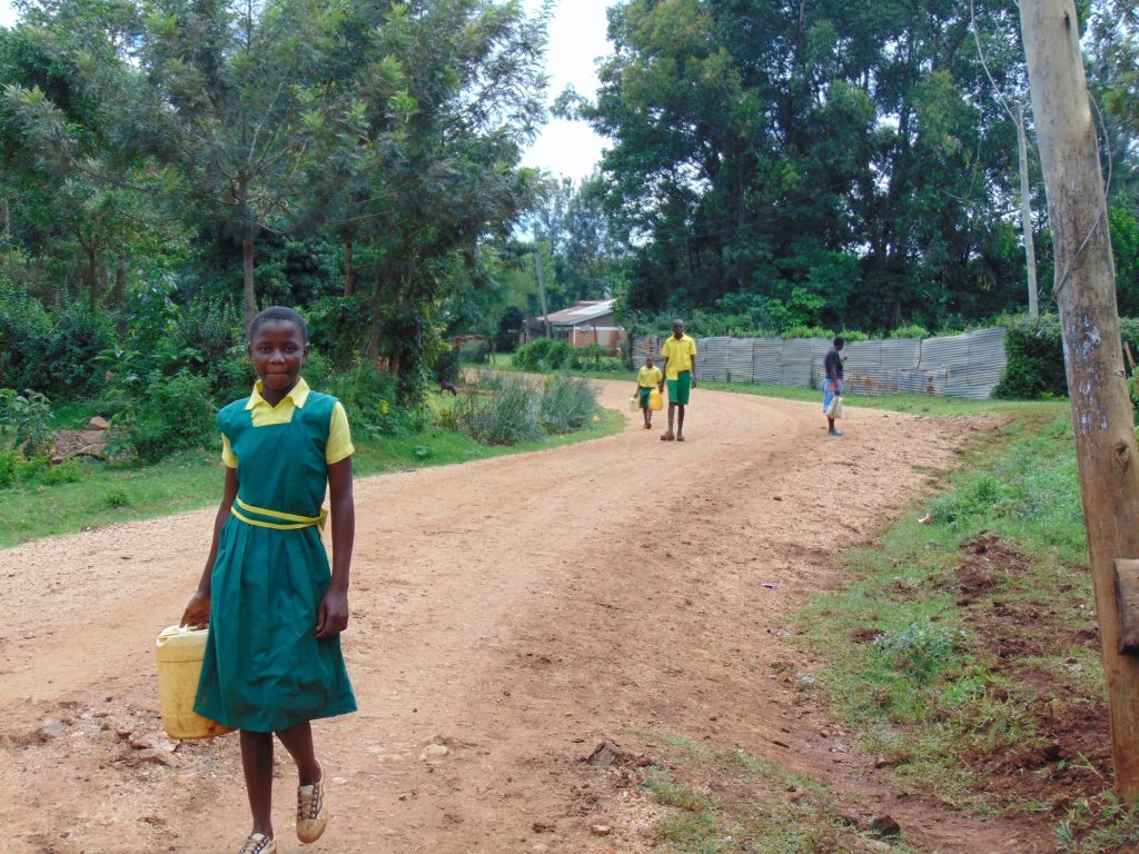 The Water Project : 2-kenya20124-students-carrying-water-to-school-4