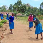 The Water Project: Gidimo Primary School -  Girls Playing On The Playground