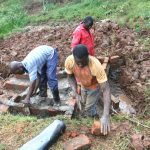 The Water Project: Shisere Community, Richard Okanga Spring -  Artisans Working On Spring Walls
