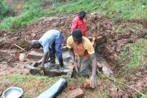 The Water Project:  Artisans Working On Spring Walls