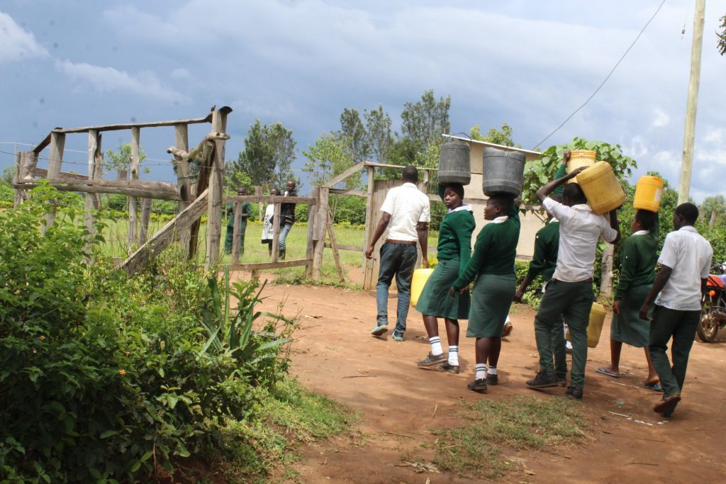 The Water Project : 20-kenya20114-students-carrying-water-from-home