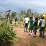 The Water Project: Sawawa Secondary School -  Students Carrying Water From Home