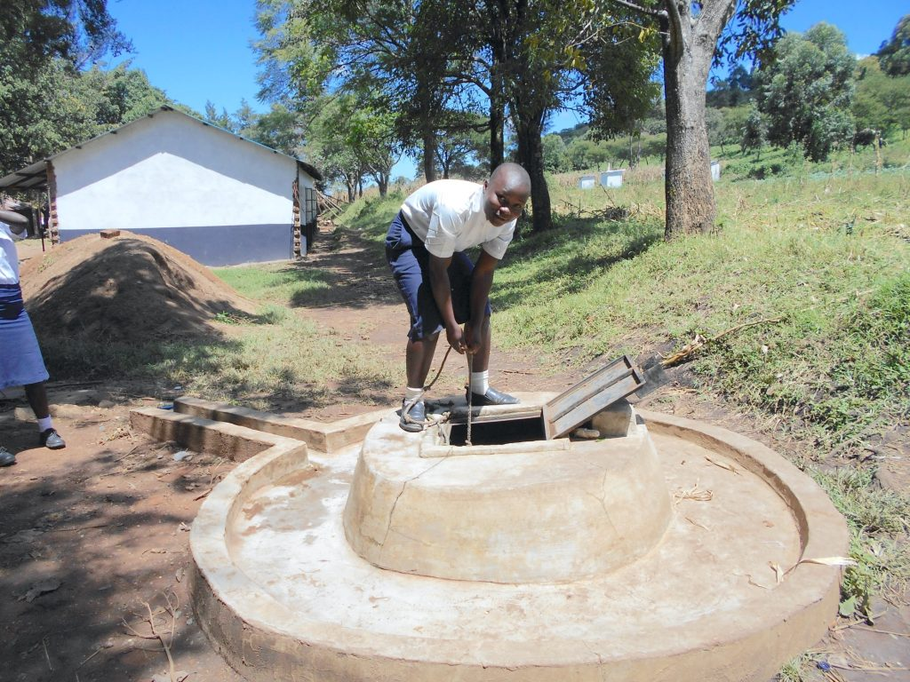 The Water Project : 20-kenya20121-student-fetching-water-from-the-well