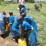 The Water Project: St. Michael Mukongolo Primary School -  Fetching Water