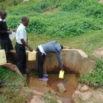The Water Project: Kinu Friends Secondary School -  Students Fetching Water At The Spring