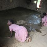 The Water Project: Mukoko Baptist Primary School -  Students Smearing Mud Classroom Floor With Cowdung As Preservative