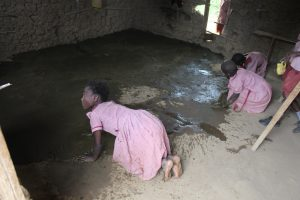 The Water Project:  Students Smearing Mud Classroom Floor With Cowdung As Preservative