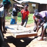 The Water Project: Ebutindi Community, Tondolo Spring -  Community Members Help Install The Platform