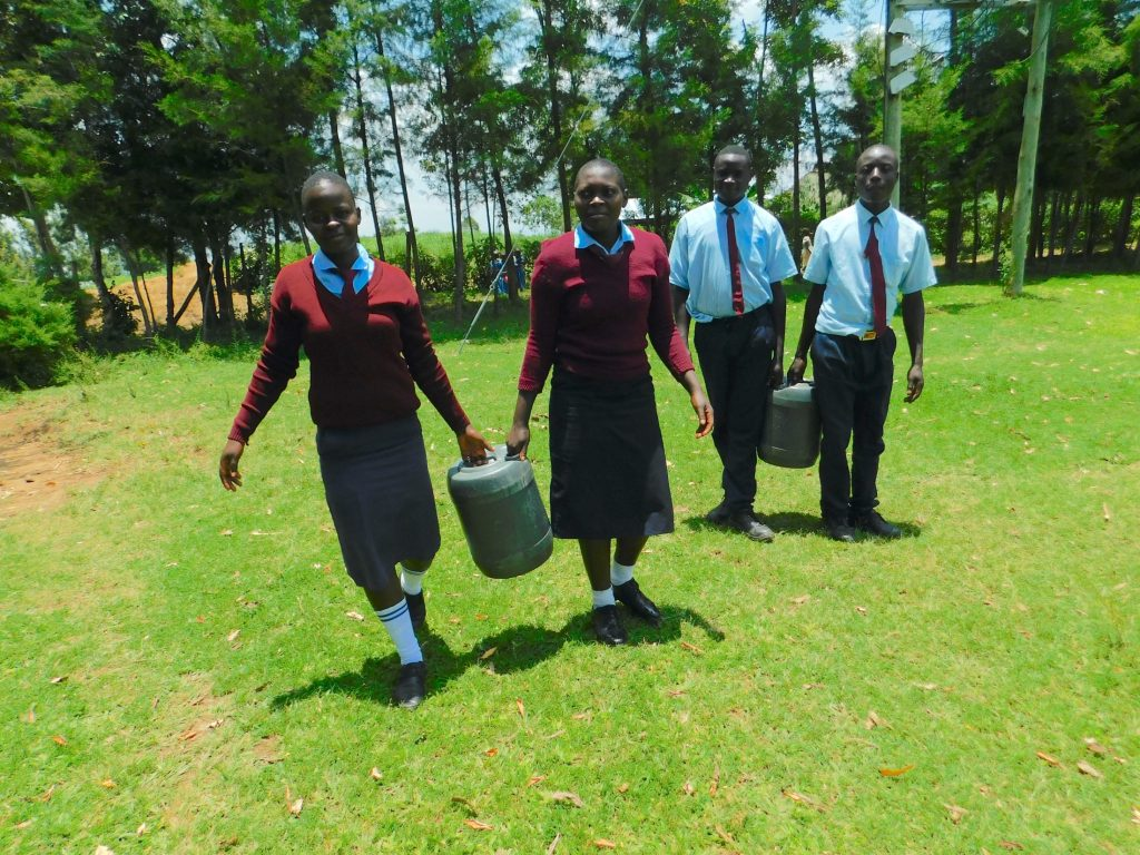 The Water Project : 22-kenya20109-students-carrying-water-2