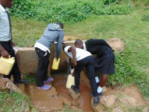 The Water Project:  Students Crowd To Fetch Water