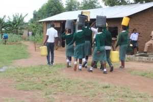 The Water Project:  Students Carrying Water From Home