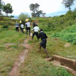 The Water Project: Kinu Friends Secondary School -  Students Carrying Water To School