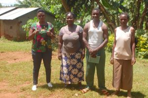 The Water Project:  Field Officer Jacklyne Chelagat With Elected Water Committee Members