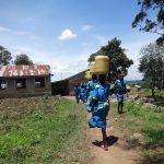 The Water Project: St. Michael Mukongolo Primary School -  Students Carrying Water
