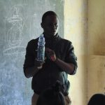 The Water Project: Gimariani Secondary School -  Explaining Solar Disinfection Water Treatment