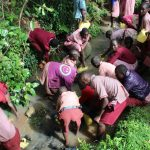 The Water Project: Mukoko Baptist Primary School -  Students Collecting Water