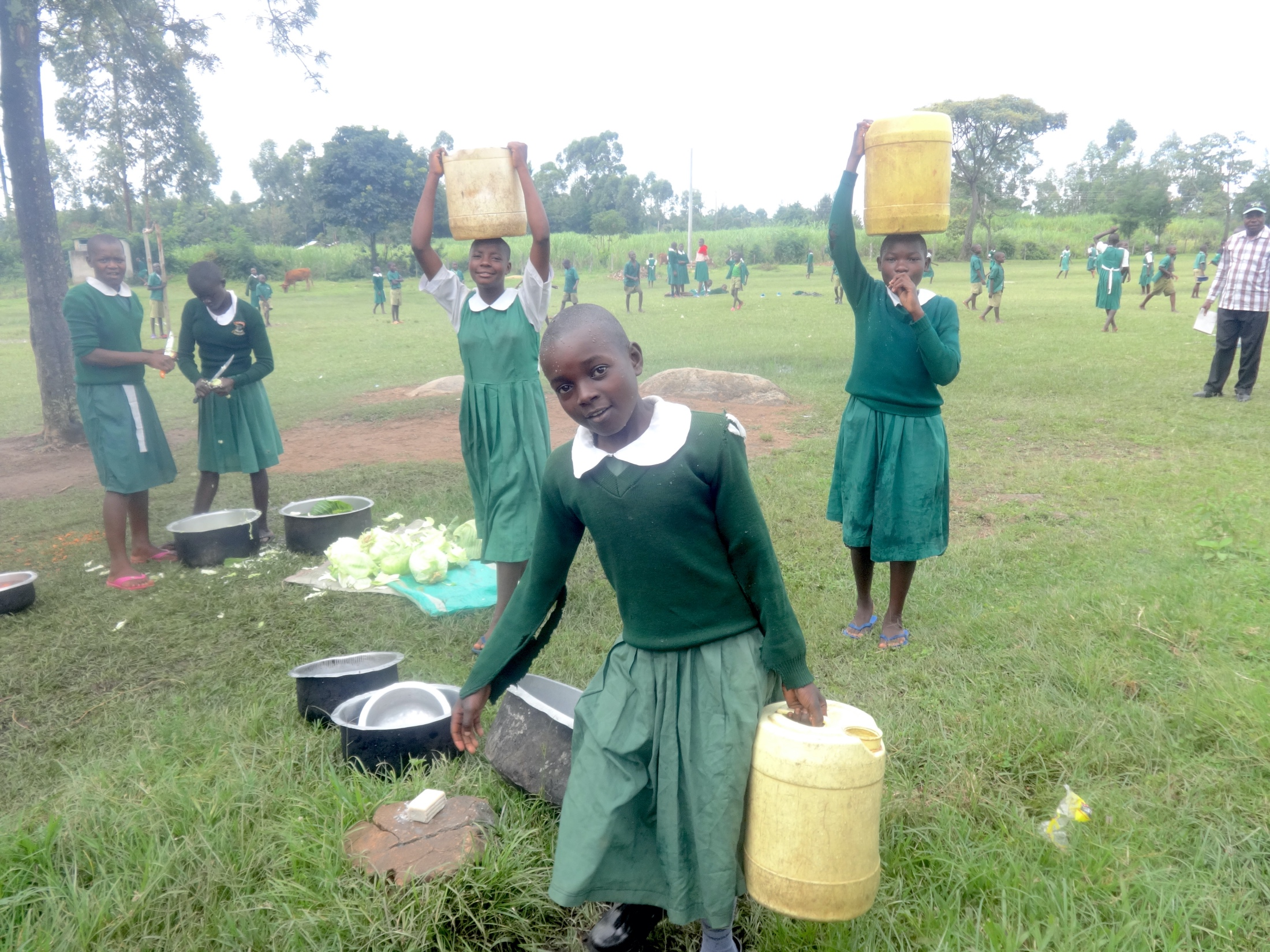 The Water Project : 29-kenya20127-students-deliver-water-to-the-kitchen