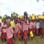 The Water Project: Mukoko Baptist Primary School -  Students Arrive At School With Water