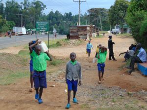 The Water Project:  Students Carrying Water To School