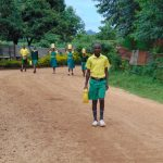 The Water Project: Gamalenga Primary School -  Students Carrying Water To School