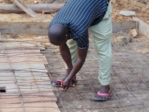 The Water Project:  Weaving The Wire For Latrine Foundation