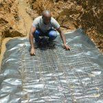 The Water Project: Bumavi Community, Joseph Njajula Spring -  Laying Foundation
