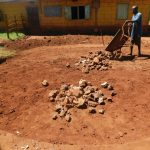 The Water Project: Friends School Mutaho Primary -  Laying The Stone Rain Tank Foundation