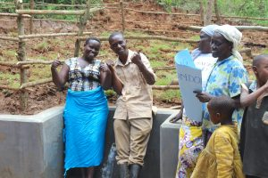 The Water Project:  Team Leader Catherine Chepkemoi And A Community Member Give Thumbs Up For Clean Water