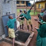 The Water Project: Friends School Mutaho Primary -  Celebrating Running Water From The Rain Tank