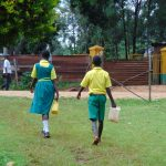 The Water Project: Gamalenga Primary School -  Students Carrying Water