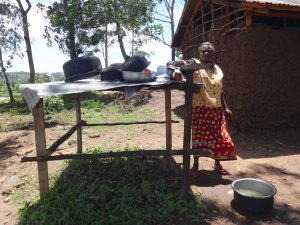 The Water Project:  School Cook At The Dishrack