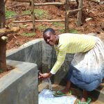 The Water Project: Ebutindi Community, Tondolo Spring -  Enjoying The Spring Water