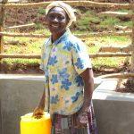 The Water Project: Bumavi Community, Joseph Njajula Spring -  Happy Community Member