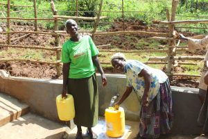 The Water Project:  Women Smile While Fetching Water
