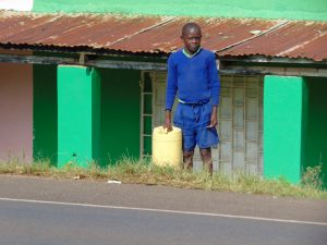 The Water Project:  Student Waiting To Cross The Road With Water