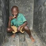 The Water Project: Friends School Mutaho Primary -  A Student Inside The New Boys Vip Latrines