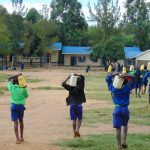 The Water Project: Boyani Primary School -  Students Carrying Water To School