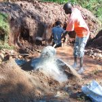 The Water Project: Ebutindi Community, Tondolo Spring -  Mixing Cement