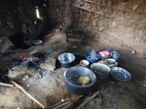 The Water Project:  Dishes And Cook Stove Inside The Kitchen