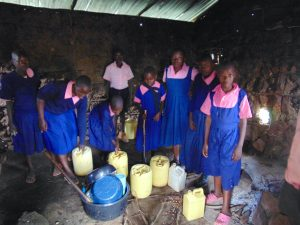 The Water Project:  Students Deliver Water Inside The Kitchen