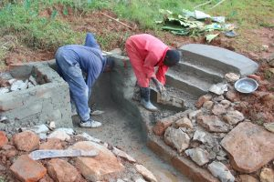 The Water Project:  Cementing The Stairs And Walls