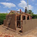 The Water Project: Gimariani Secondary School -  Framing Latrine Doors And Roof