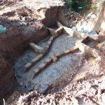 The Water Project: Ebutindi Community, Tondolo Spring -  Brick Setting Over Concrete Foundation