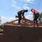 The Water Project: Gimariani Secondary School -  Working On Latrine Roof