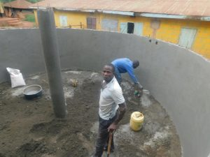 The Water Project:  Central Pillar In Place And Plastering