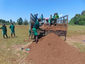 The Water Project:  Offloading Dirt For Construction